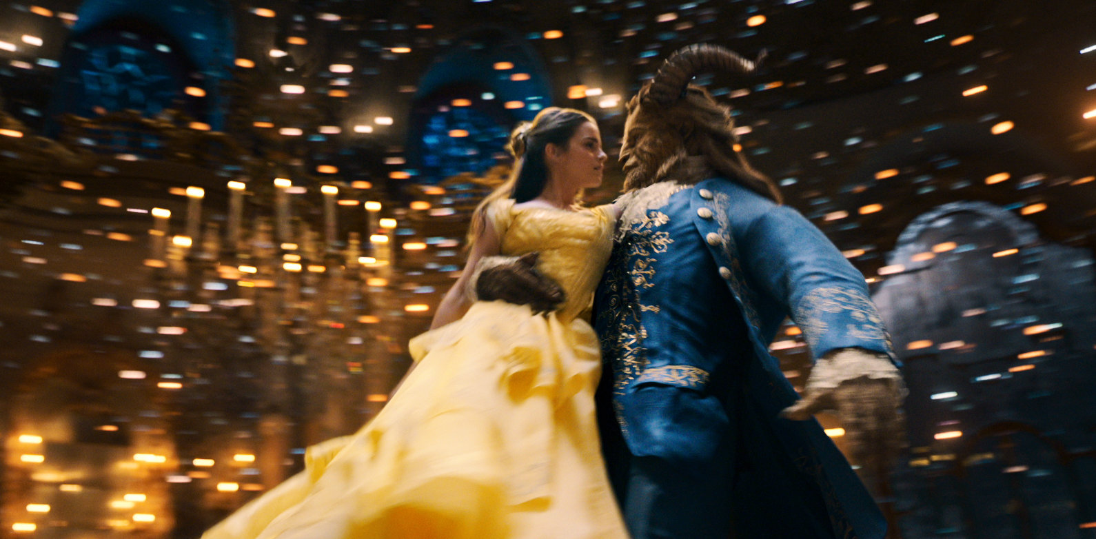 Belle (Emma Watson) and the beast (Dan Stevens) dance in the iconic ballroom scene of the live-action