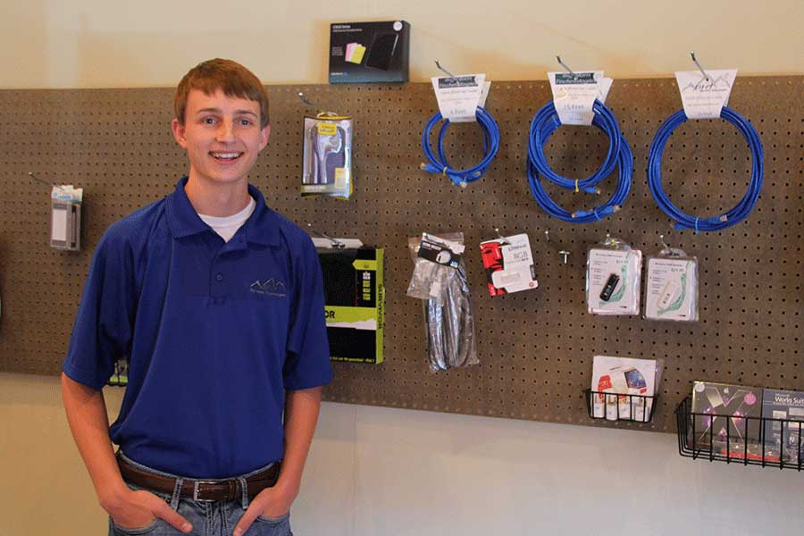 Corbin shows off his merchandise at Big Horn Technologies on Brundage.