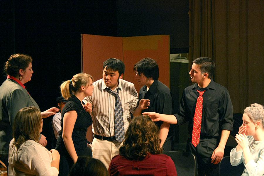 Senior Dylan Lindly separates a fight between two co-stars in the SHS production of Twelve Angry Jurors.