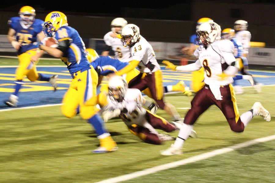 Senior Daniel Sessions rushes the ball against the Laramie defense. Sessions scored two touchdowns.