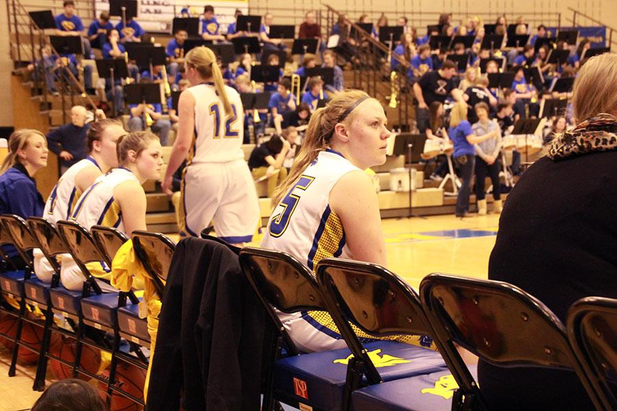 Senior Alison Geary sits on the bench during halftime of the girls' basketball game against Gillette.