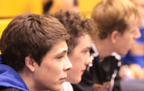 Gage Tyree and Cody Delk look on as they wait for their matches.