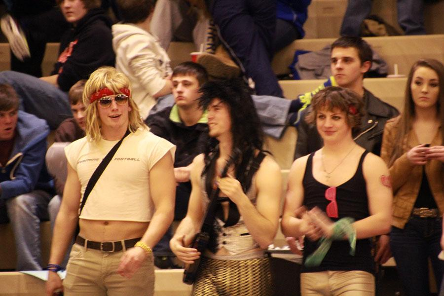 From left, seniors Ethan Hall, Tyler Julian, and junior John Henderson looked on in their rock and roll themed consumes.