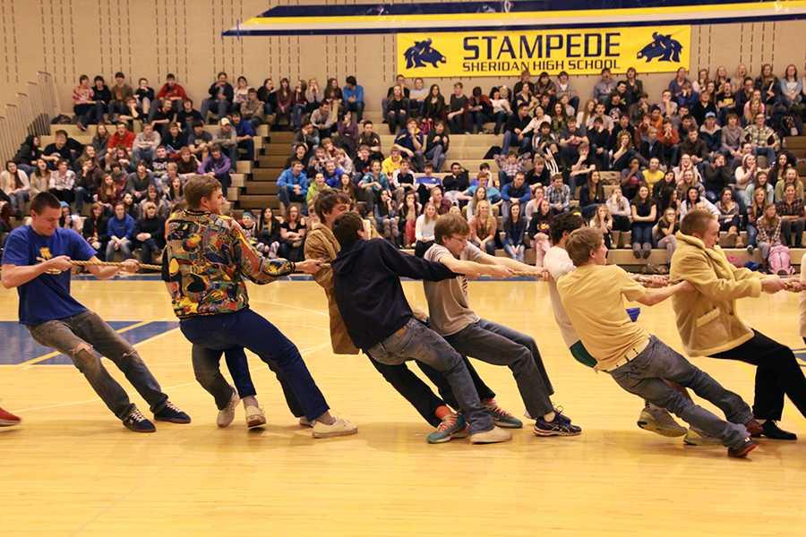SHS students play tug of war at the assembly.