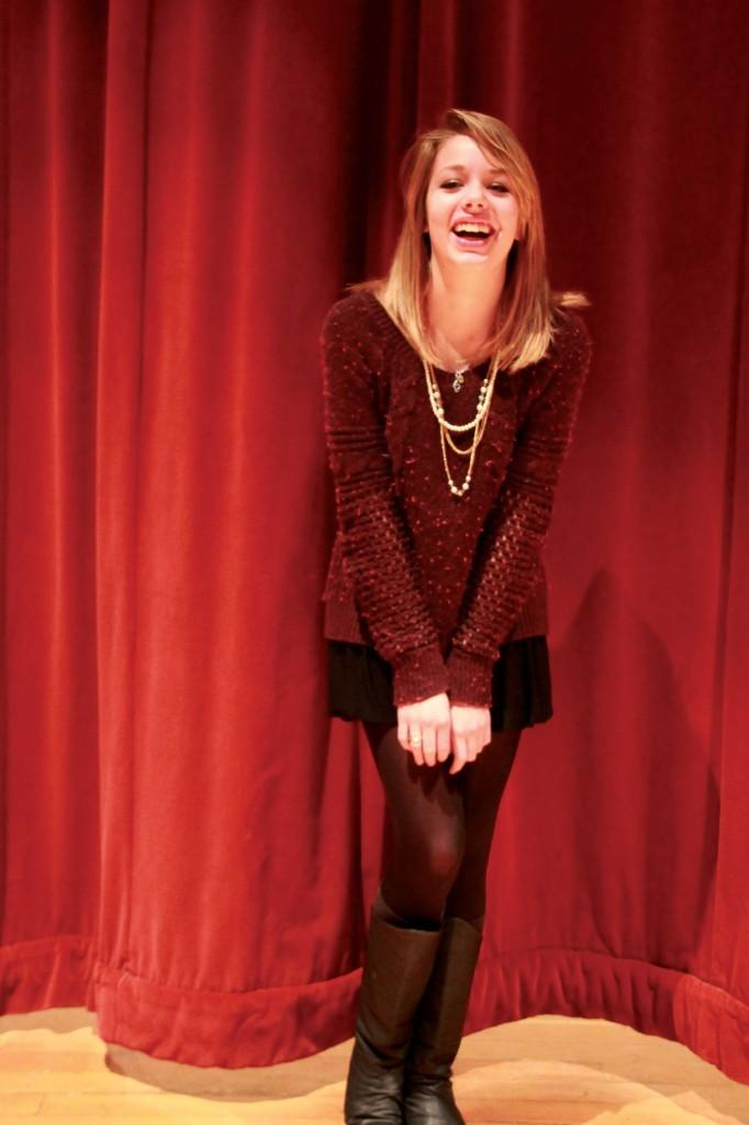 Mariah giggles before rehearsal in the auditorium. Oleson plays Sandy in this years musical,