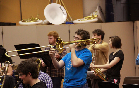 Junior Timothy Goodell plays his part in the jazz band during class Friday