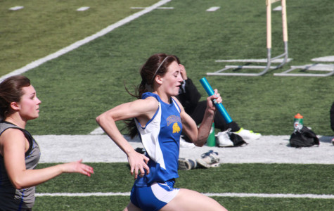 Senior Madison McClure races down the final leg of the girls 4x100 meter relay