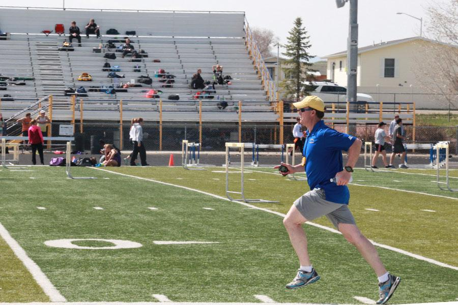 Track coach Art Bowers sprints along the infield demonstrating excellent form.