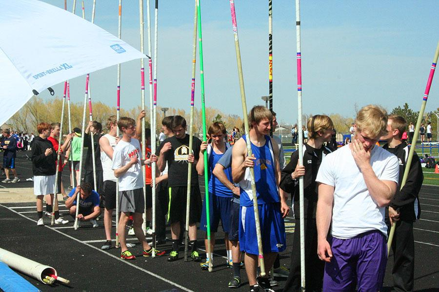 Pole Vaulters line up as they wait for their turn to compete.