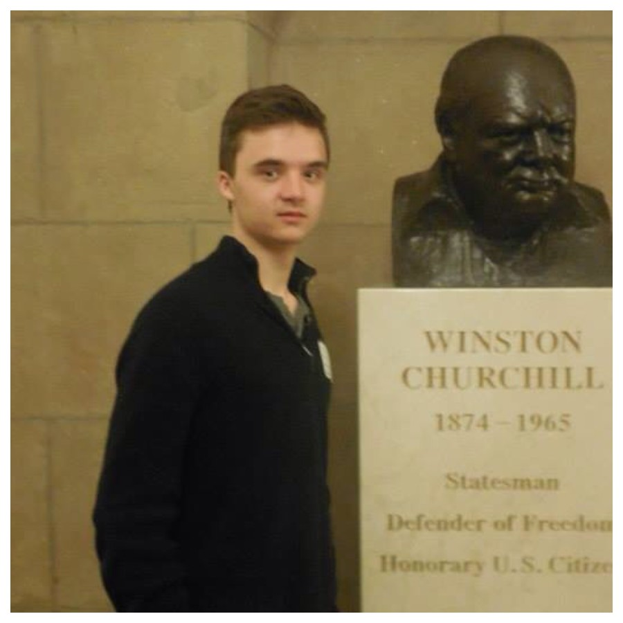 Jahiel+poses+with+a+bust+of+Winston+Churchill%2C+whom+he+finds+very+inspiring.