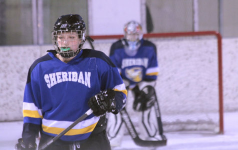 Junior Molly Mann looks on the rink and assesses her team's position.