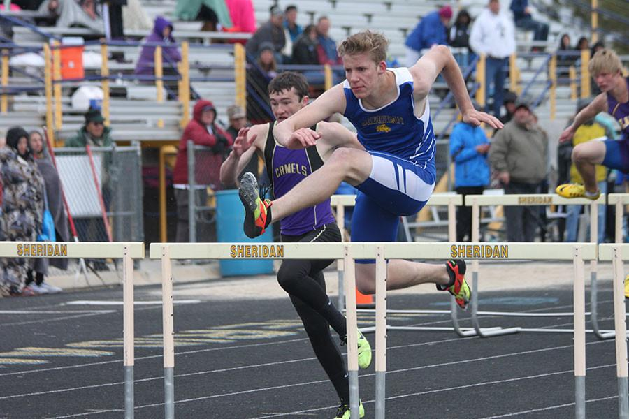 Cameron Craft shows perfect form in the 300 meter hurdles