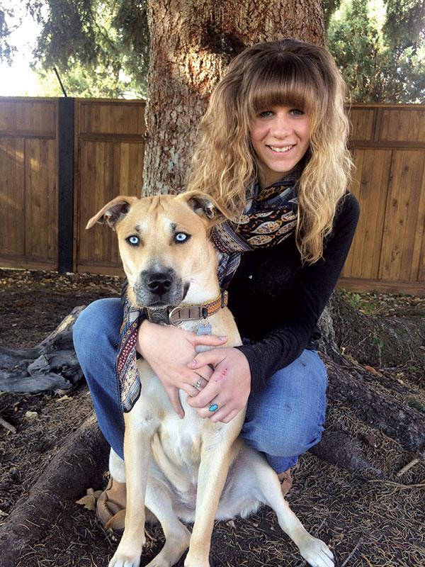 Olivia Eldridge poses with her dog, Junabee, she explains,