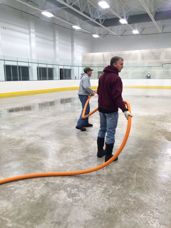 Sheridan+on+Skates+Board+Vice+President+Dan+Carlin+and+volunteers+around+the+community+came+together+on+Saturday+Nov.+21%2C+2015+to+lay+ice+and+begin+the+process+of+painting+the+ice+and+laying+lines.+On+Nov.+22+the+re-grouped+and+finished+laying+the+lines+for+the+upcoming+season.