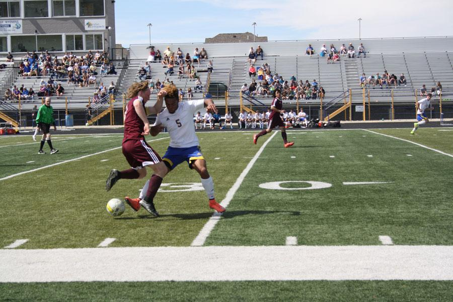Senior Dontae Crow attempts to steal the ball from a Laramie opponent.