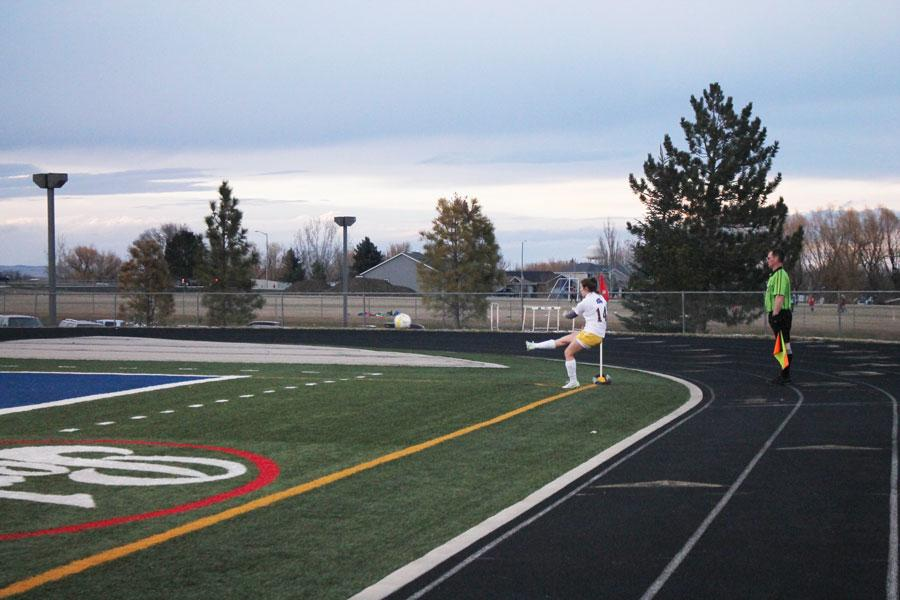 Senior Jamy Shassetz performs a corner kick after the ball was knocked out of bounds.