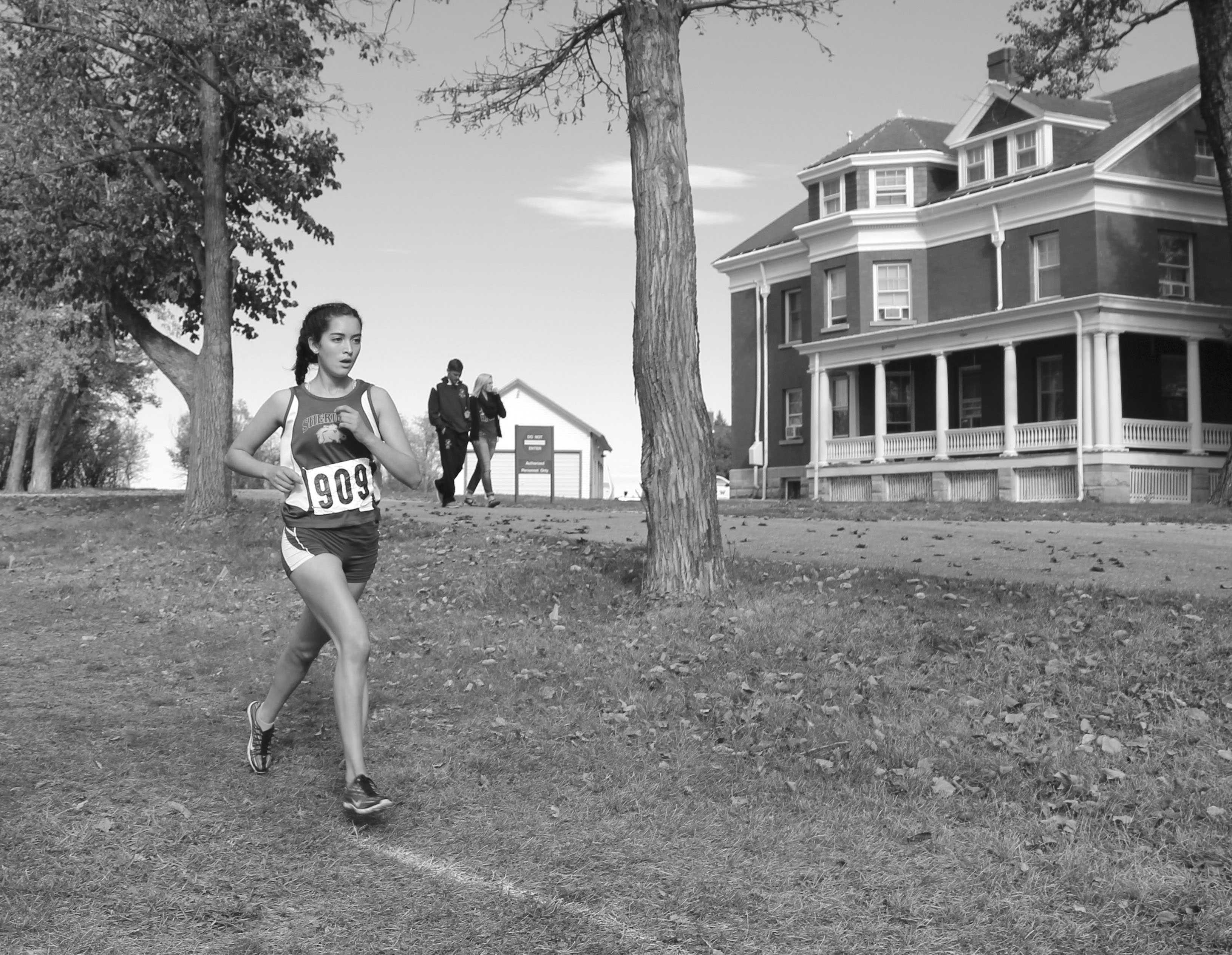 Senior girls varsity runner Xiomara Robinson races through the last quarter mile of her 5K at the Sheridan VA Medical Center state cross country meet on Saturday, Oct. 22, 2016.