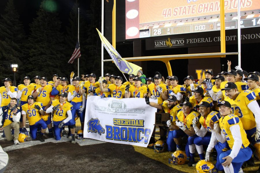 Sheridan+Broncs+football+players+kneel+for+a+celebratory+picture+after+winning+their+third+consecutive+state+championship.+%28Photo+Brian+Rizer%29