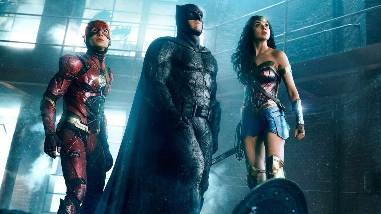 The Flash (Ezra Miller), Batman (Ben Affleck), and Wonderwoman (Gal Gadot) stand ready to battle Steppenwolf. (Photo courtesy DC Films)