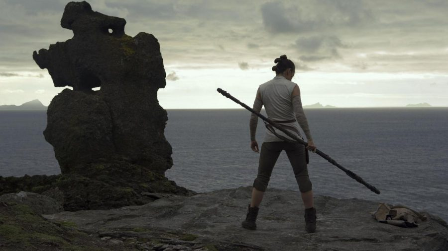 Rey (Daisy Ridley) trains her combat skills on Luke Skywalker