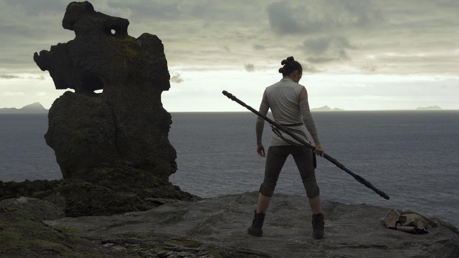 Rey (Daisy Ridley) trains her combat skills on Luke Skywalker's hideout. (Photo courtesy Lucasfilm)