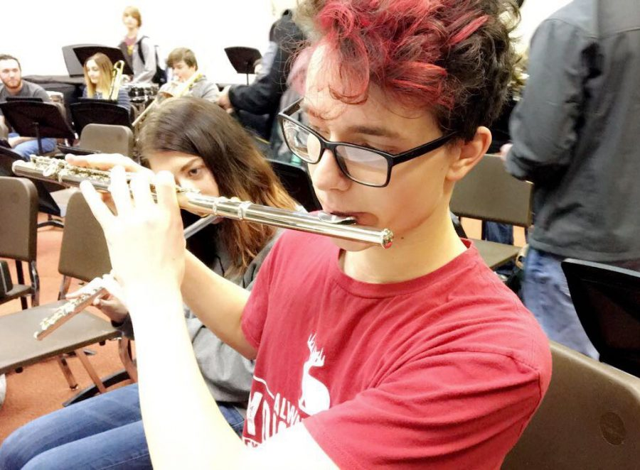 Senior Tristan Murdoch practices off sheet music before a high school band concert. (Photo Bailey Hanson)