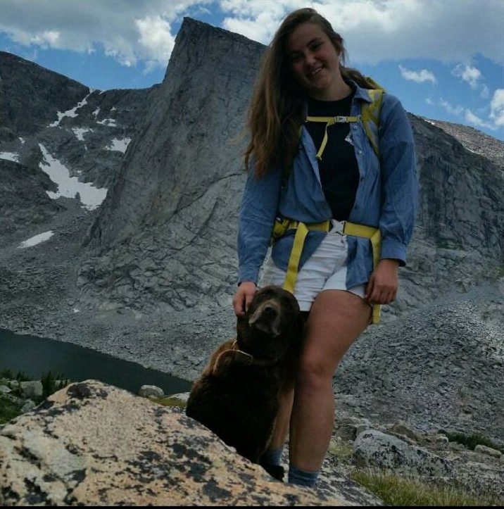 Bensel stands for a photo in the mountains with her dog. (Photo courtesy Kris Korfanta)
