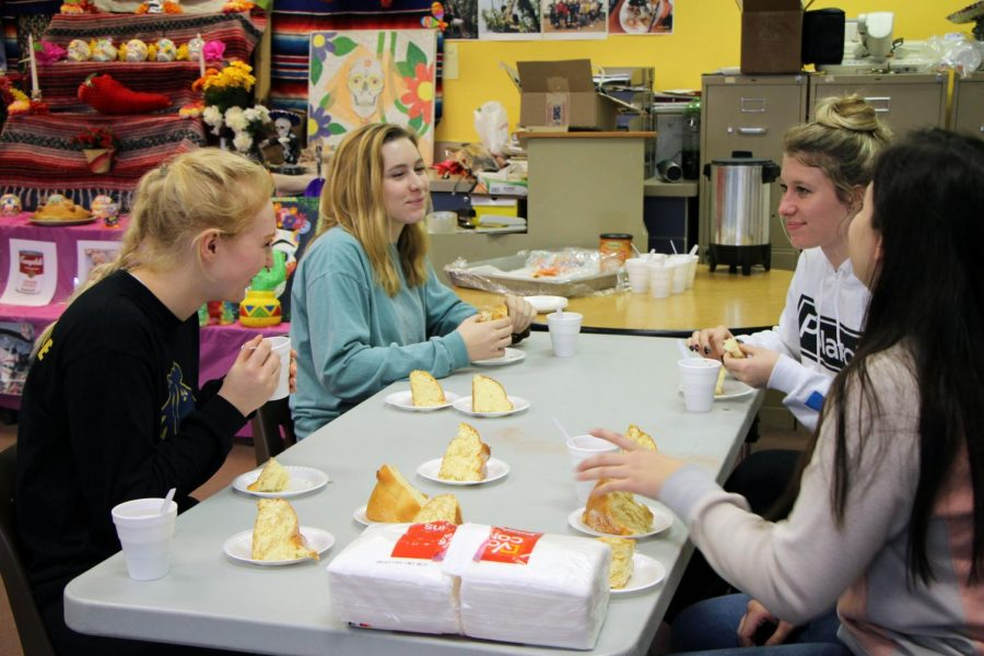 Spanish students enjoy traditional Pan De Muerto and hot chocolate during their Day of the Dead celebration.