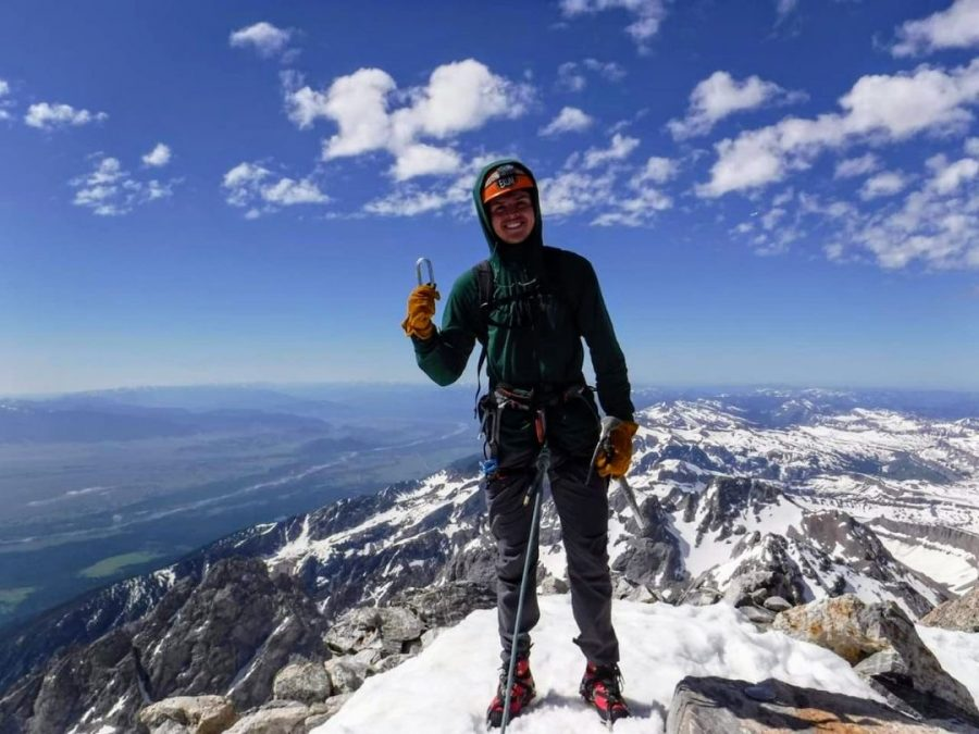 Heeren stands atop the Grand Tetons after a successful climb. He completed ascent 50 years after his grandfather accomplished the same feat.