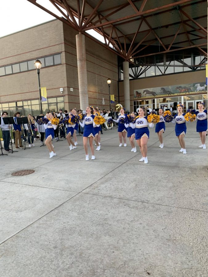 SHS cheer squad leads student body in cheers in front of Sheridan High School at the burning of the bronc ceremony on Wed. Oct. 2.