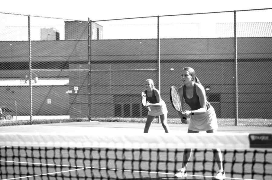 Junior+Annie+Mitzel+and+Freshman+Gillian+Mitzel+prepare+for+match+at+Sheridan+High+School.