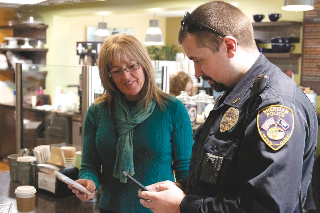 The Hub on Smith assistant of fun Lisa Wells and Sheridan Police Department officer Aaron Hartman have a small-world moment during
