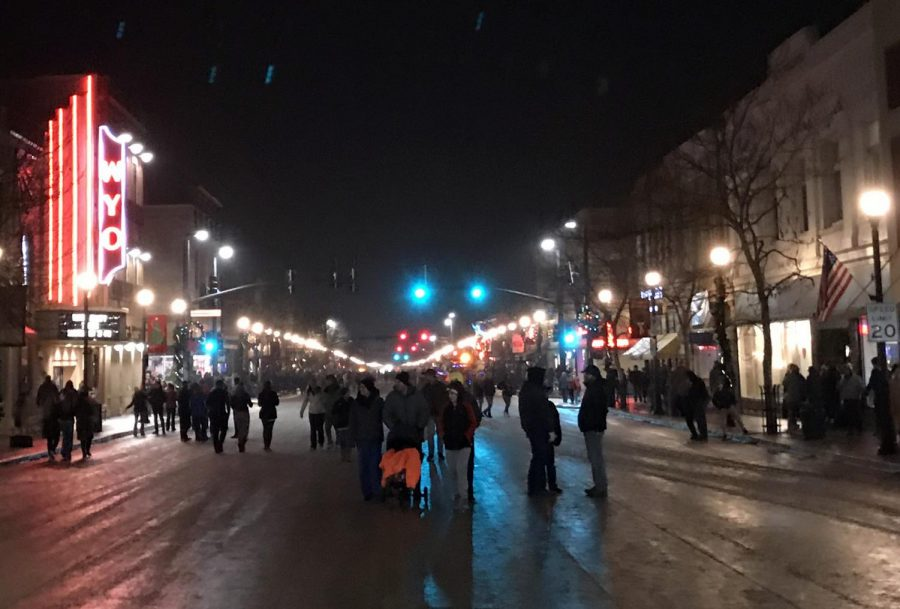 Family+and+friends+walk+through+the+decorated+Main+Street+in+downtown+Sheridan+in+celebration+of+the+holiday+season.