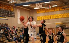 Junior Sam Lecholat drives to the basket against Buffalo defenders.