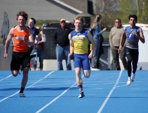 Senior Brock Bomar competes in the 100 meter dash at the Homer Scott field track during the 2019 outdoor season.