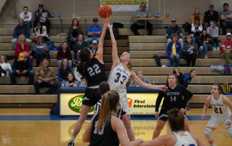 Senior Katie Ligocki jumps for the tip off during the Billings Skyview home game.