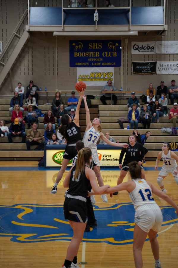Senior+Katie+Ligocki+jumps+for+the+tip+off+during+the+Billings+Skyview+home+game.+