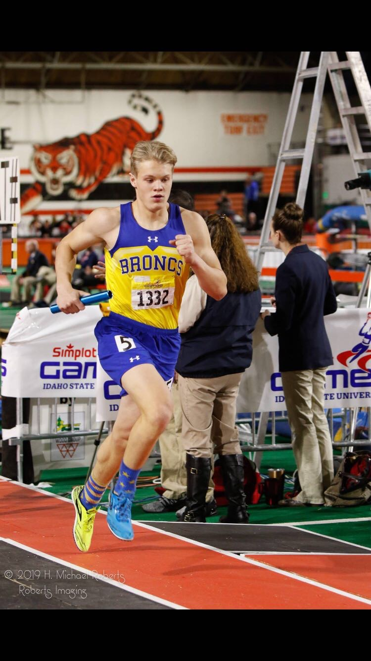 Shaw runs the 4 by 800 relay at Simplot games in the 2019 track season.
