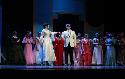 Cinderella, played by Mallory Arneson, and Prince Topher, played by Zane Meyers, share a moment before dancing to Richard Roger and Oscar Hammerstein's