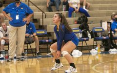 Addy Bolton, a senior liber for the Sheridan volleyball team, gets ready for the opposing team to serve during a home game.